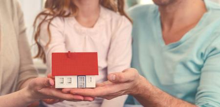 holding home as symbol family Banco de Imagens