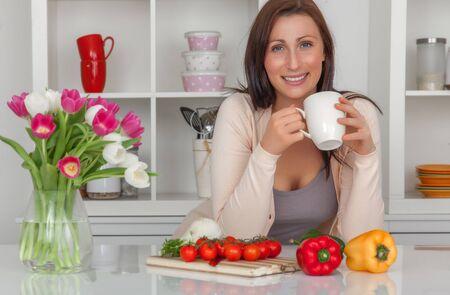 kitchen female having coffee break