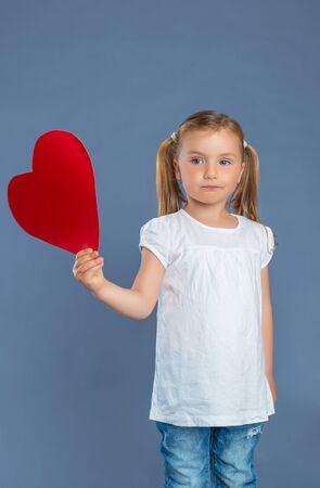 cute heart holding little girl