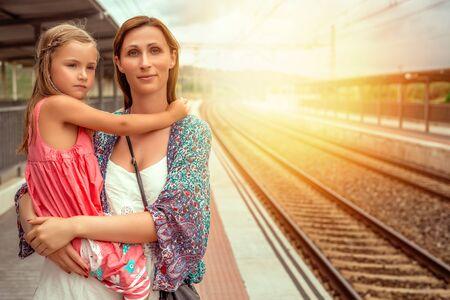 train waitng woman with girl
