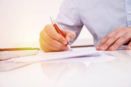 signature under contract hands macro shot