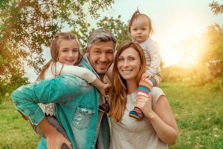 hugginh family portrait of four