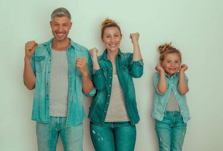 happy family having success winner pose