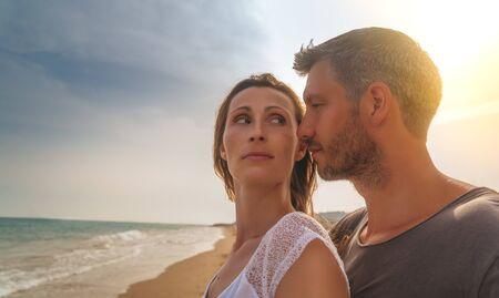 couple on the sunset beach 版權商用圖片