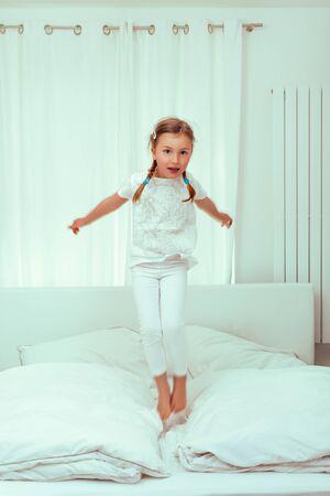 bedroom happy jump little girl