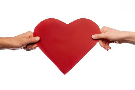 hands holding red love heart