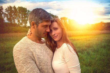 landscape couple standing in higher grass 版權商用圖片