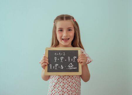 little girl with chalkboard