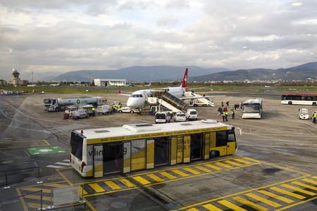 Florence, Italy: November, 2016: Swissair airbus is having luggage removed from the hold as passengers disembark from the flight. Swissair AGSA was for many years the national airline of Switzerland