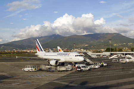 Florence, Italy: November 20, 2016: An Air France airbus is having luggage stowed before passengers board the flight at. Air France is the French flag carrier headquartered in Tremblay-en-France Sajtókép