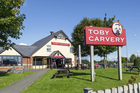 Swansea, UK: September 19, 2017: Front view of a Toby Carvery restaurant. Toby Carvery are a chain brand of over 150 restaurants established for over 30 years. Home of the Roast is their slogan Editorial