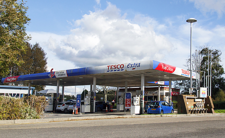 Llanelli, UK: September 21, 2017: Customers are using the dispensers to fill their cars with petrol at a Tesco Petrol Station
