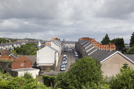 Swansea, UK: June 2017: Traditional terraced houses in a Swansea suburb. Overview of roofs and chimneys