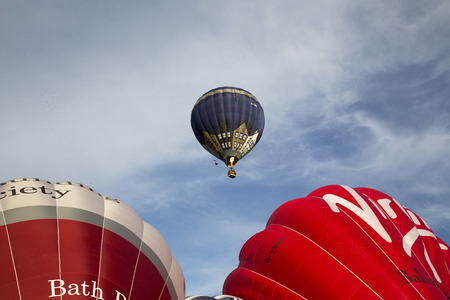 Bristol, UK: August 13, 2016: Inflating the balloons at the Bristol International Balloon Fiesta. The annual event has become Europe's largest hot air balloon festival Sajtókép
