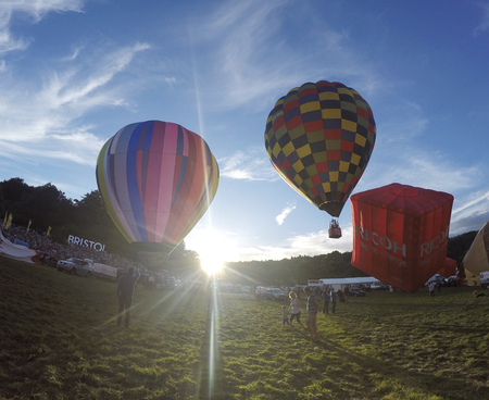Bristol, UK: August, 2016: Flying a balloon at the Bristol International Balloon Fiesta. The annual event has become Europe's largest hot air balloon festival