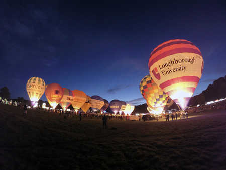 Bristol, UK: August 13, 2016: Night Glow at the Bristol International Balloon Fiesta. The annual event has become Europe's largest hot air balloon festival. The Loughborough University balloon Editorial