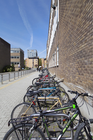 Swansea, UK: May 04, 2016: Bicycles are secured against theft at Swansea University Singleton Campus