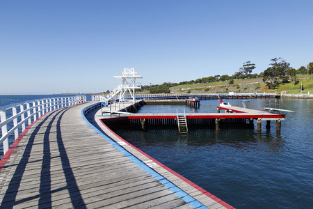 Geelong, Australia: April 03, 2017: Eastern Beach Swimming Enclosure on Corio Bay opened in the 1930s it is a protected seawater swimming pool with lifeguards, childrens area and a shark gate