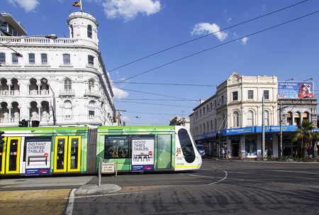 Melbourne, Australia: April 05, 2017: An overhead cable car with advertising is traveling towards the city.