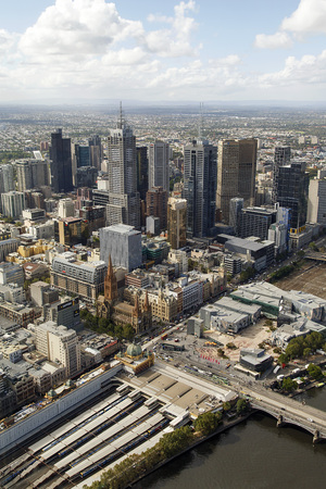 Melbourne, Australia: March 30, 2017: View of Flinders Street Station and the city of Melbourne from the Eureka Sky Tower. The tower is a 297 metre high and the tallest building in Victoria State.