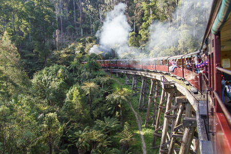 Melbourne, Australia: October, 2015: Puffing Billy is an historic 2ft 6in narrow gauge heritage railway in the Dandenong Ranges near Melbourne. Passengers can be seen sitting on the train