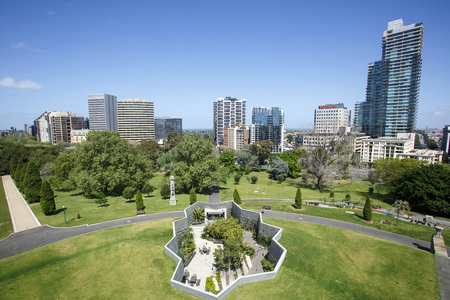 Melbourne, Australia: October 07, 2015: Cityscape of Melbourne high-rise residential and office buildings on the skyline from the Shrine of Rememberance