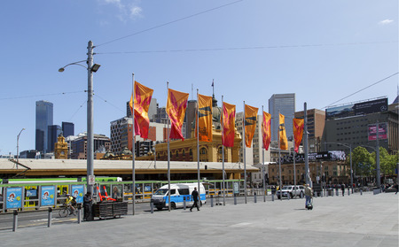Melbourne, Australia: October 07, 2015: External view of Flinders Street Station near Federation Square in Melbourne. It is the main railway station in and pedestrians are walking by. Sajtókép