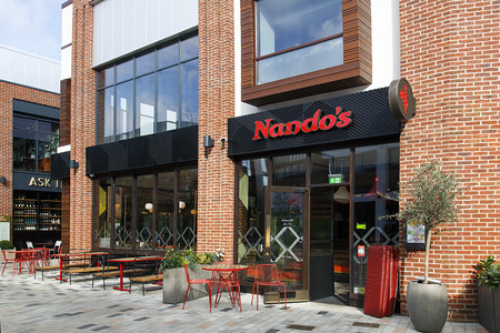 Stratford upon Avon, UK: October 14, 2017: Nandos is an international casual dining restaurant chain originating from South Africa, with a MozambicanPortuguese theme, founded in 1987.