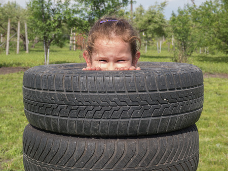 naughty girl: naughty girl peeps out of the tires