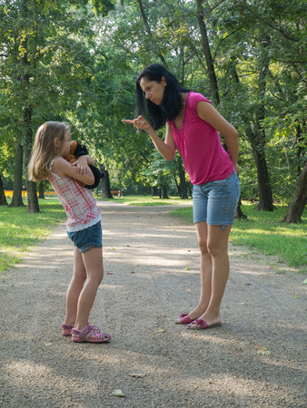 frantic: Mother is disciplining her 6-8 years old daughter. Girl Stock Photo