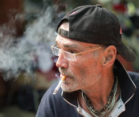 poorness: Man is smoking
