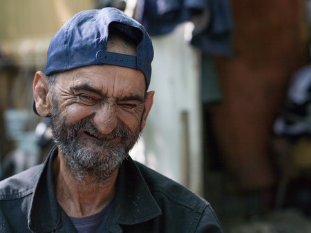 old homeless man with big smile