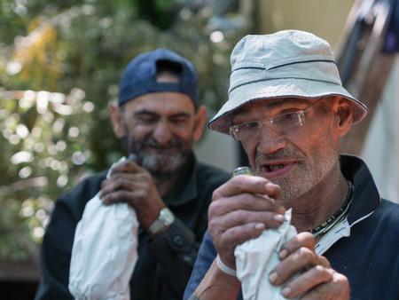 poorness: two homeless men drinking