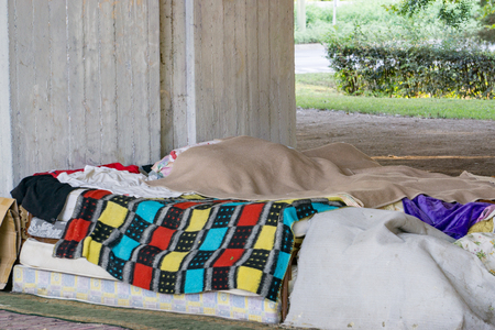 a homeless mans stuffed-up stuff under the bridge Stock Photo