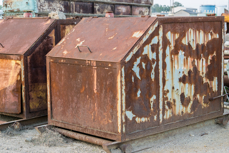 rusty waste containers in the industry