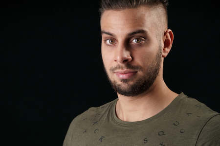 headshot photo of a young and handsome bearded man in a studio with a flash Stok Fotoğraf