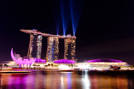 marina bay sand: Singapore cityscape at night buildings of Marina Bay Sand laser show , Singapore - 30 January 2015 Editorial