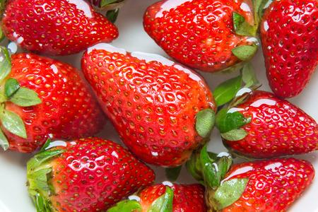 soak: Strawberry soak water in white bowl Stock Photo