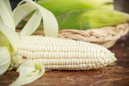 fresh white corn on wooden background