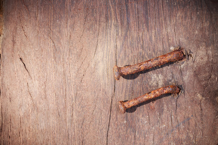 rusted background: Rusted nails sticking on old wooden background