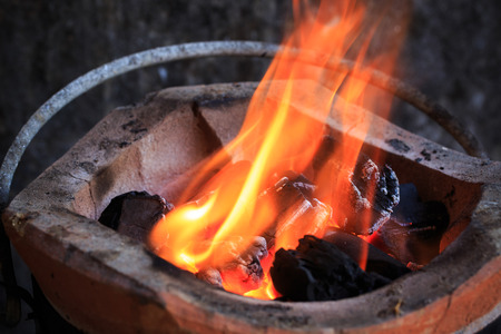 fire burning billets charcoal in hot stove