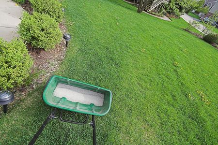 lawn fertilizer spreader Stock Photo
