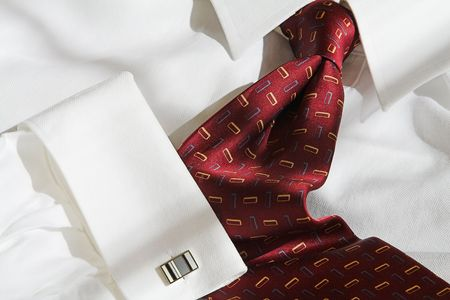 red tie with dress shirt and cuff link photo