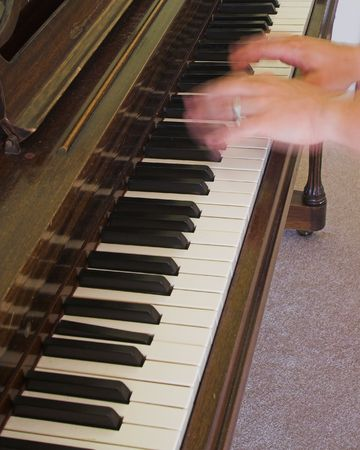two hands in motion playing piano photo