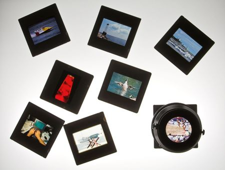 stock photography: 355 slides on lightboard with loupe Stock Photo