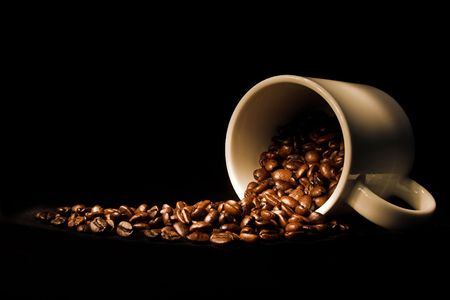 caffiene: coffee cup and spilled coffee beans