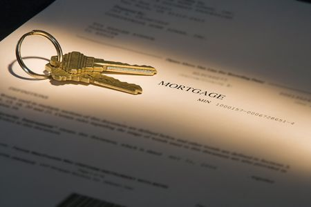 in escrow: mortgage document with keys highlighted