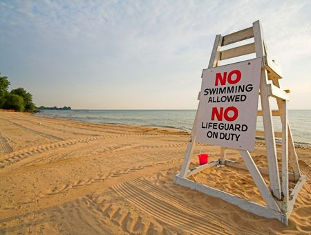lifeguard chair with sign saying no swimming photo