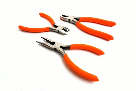pounding: 3 orange handle pliers on white Stock Photo