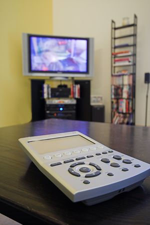 telly: tv remote control on coffee table Stock Photo